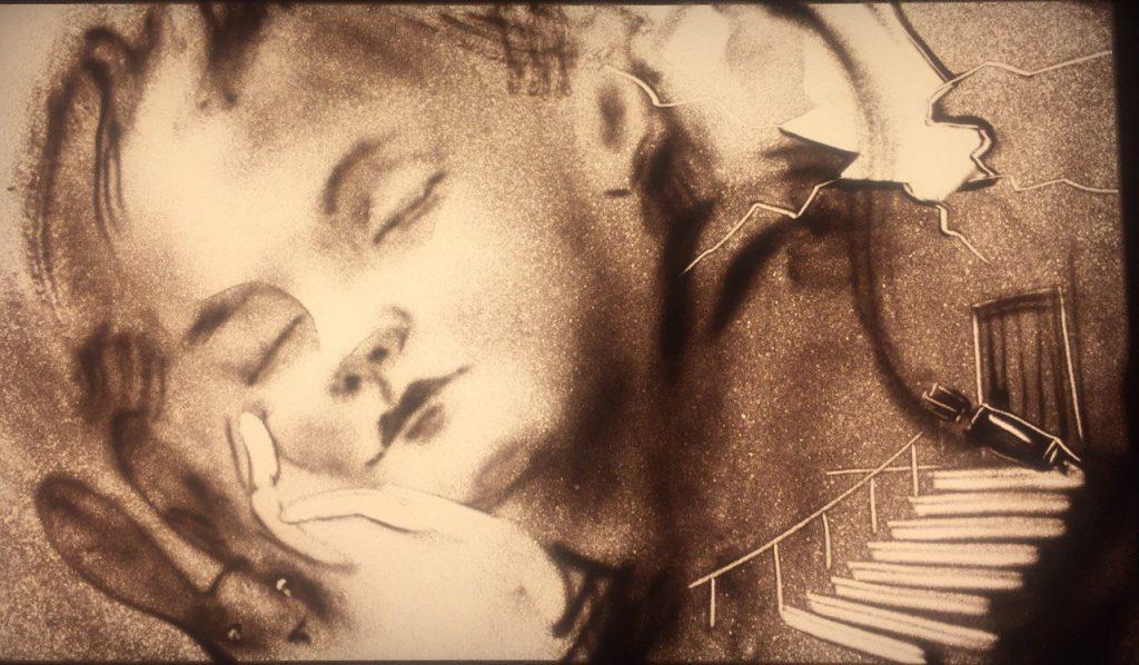 Иллюстрация к спектаклю «Помню», созданная на песке